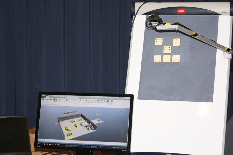 Digitális gyártás és termelés tervezés   A szcenárió az egyes cellák, gyártósorok, csarnokok fizikai berendezésének szimulációjára mutat megoldást. A szimulációval optimalizáljuk meg a sorok fő teljesítményjellemzőinek (KPI) értékeit, mint többek között a kihozatalt, a gépek kihasználtságát vagy a gépek mellett dolgozó operátorok leterheltségét. Az cella elrendezés gyors beviteléhez egy flipchart-on helyezzük el a gépeket szimbolizáló kártyákat, amit egy kamerás rendszer digitalizál.   Együttműködő partner: MTA SZTAKI